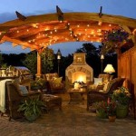 out door fireplace living area with outdoor kitchen space