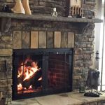 custom iron fireplace door in craftsman style